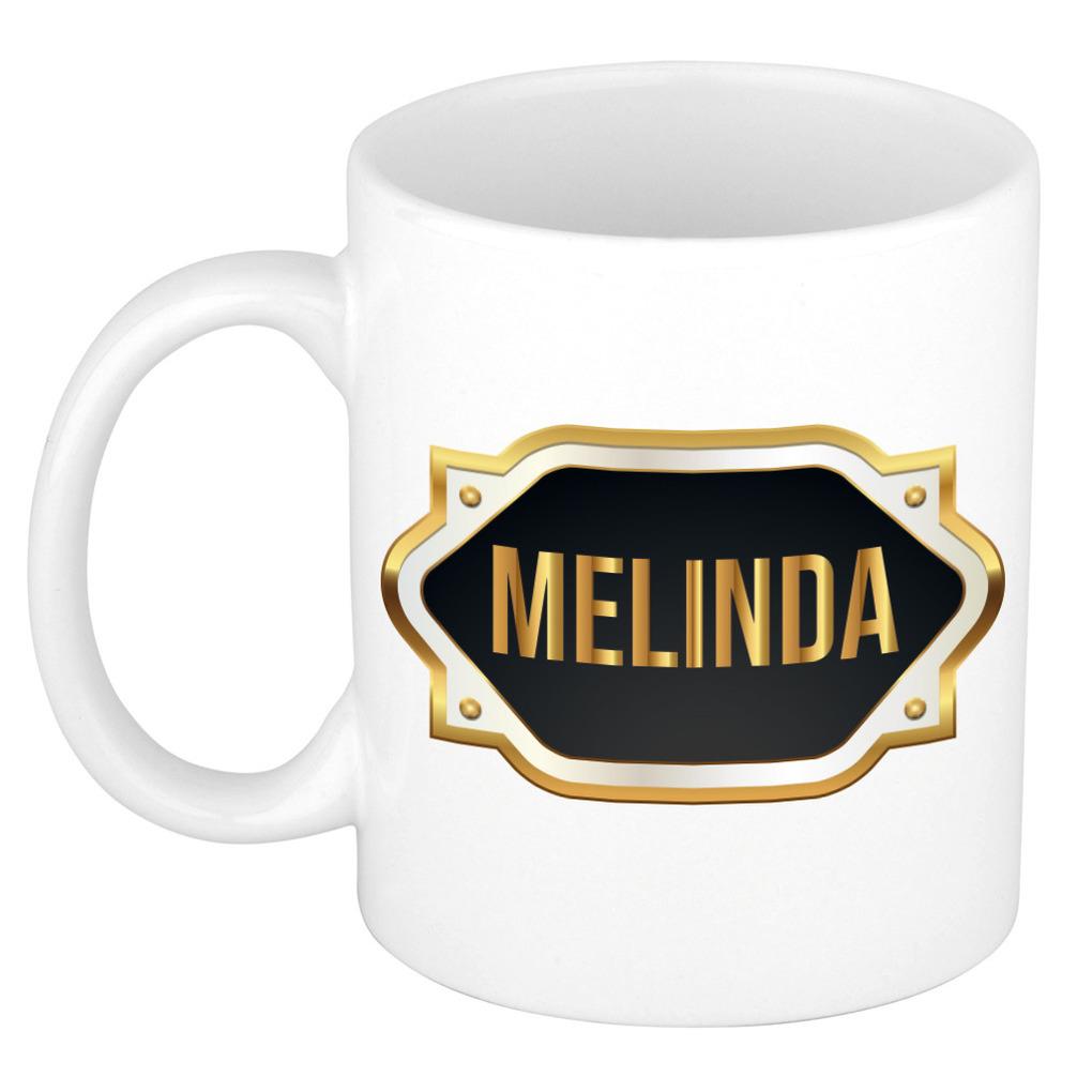 Naam cadeau mok / beker Melinda met gouden embleem 300 ml